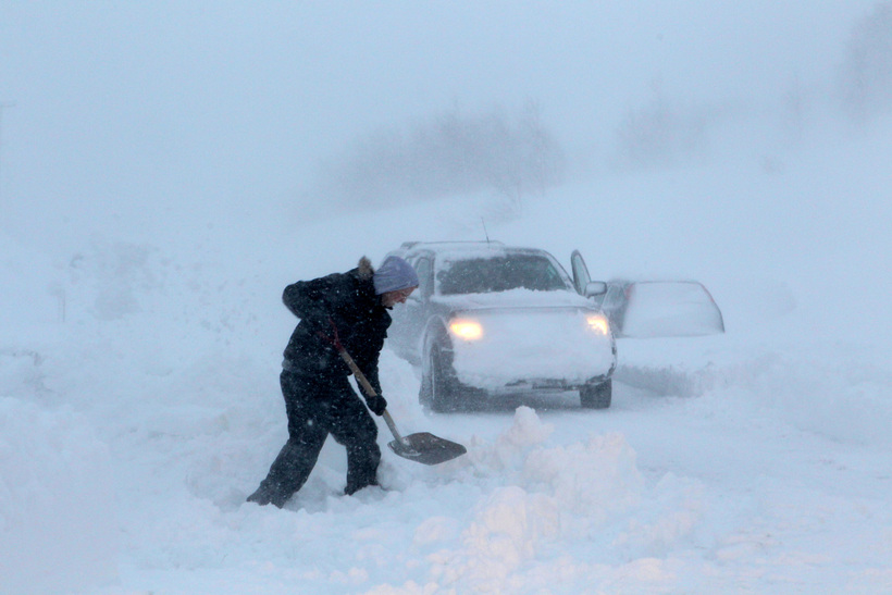Man Shoveling Snow with His Car Stuck