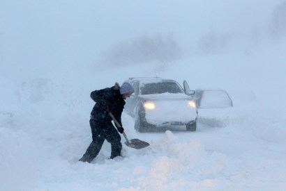 Man Shoveling Snow with His Car Stuck></a> 				</div> 				<div class=