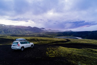 a car driving on iceland's ring road></a> 				</div> 				<div class=