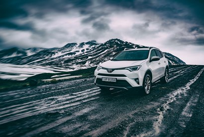 Toyota SUV driving on Icelandic Dirt Road over Mountain></a> 				</div> 				<div class=