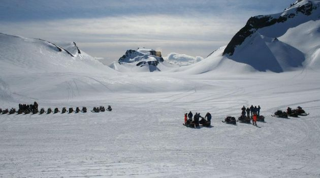 Group of Snowmobilers on Icelandic Mountains