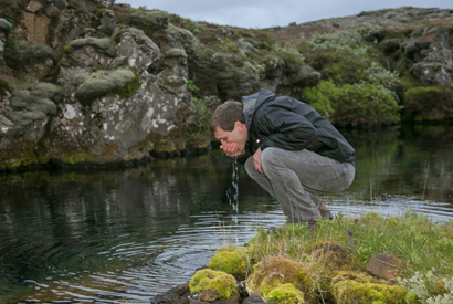 Man drinking water from Icelandic Spring></a> 				</div> 				<div class=